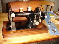 The Harris No. 9 H hand cranked sewing machine. With hemming attachment, needles and 6 spare bobbnis