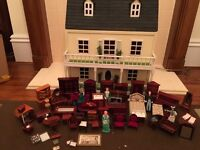 Dolls house with 70 items of good quality furniture