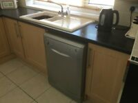 Kitchen units , worktops , gas hob and dishwasher .