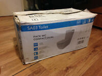 Ceramic Toilet, brand new, in original packaging.