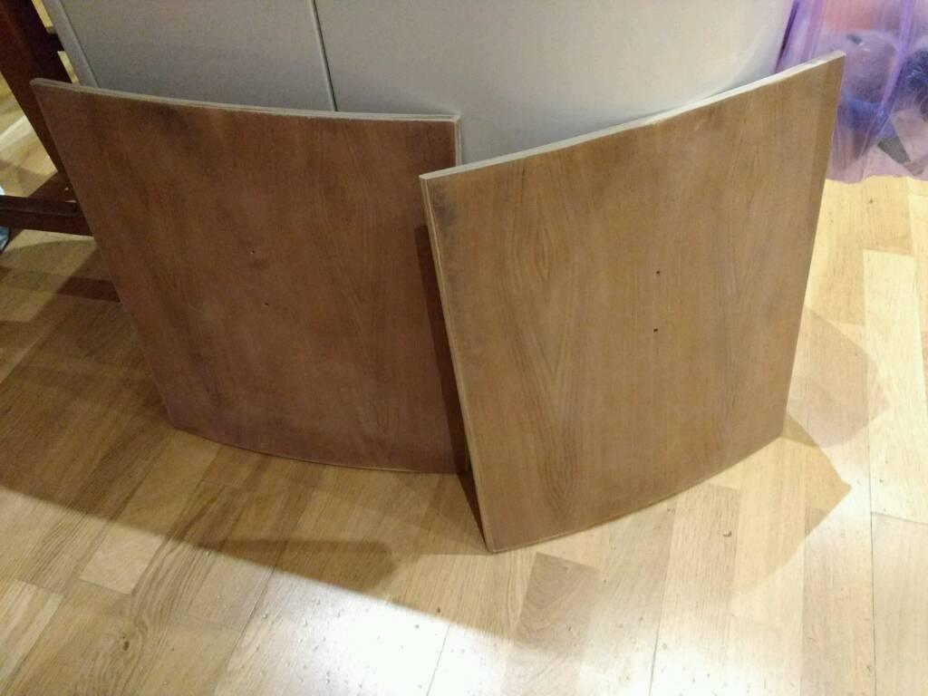 Curved walnut veneer cabinet doors