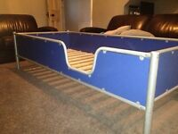 Childs very sturdy metal and wood bed frame