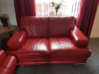 DFS 2 & 3 seater red leather sofas with 2 footstools
