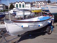 16 foot open fishing boat with 9.9 mariner yamaha engine