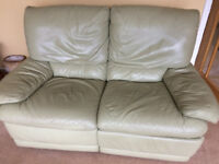 2 Italian Leather sofas -light green with one manual recliner/sofa