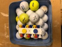 Box of 29 golf balls plus some practice balls and tees