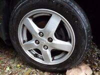 4 x wheels/trim off Toyota Corolla
