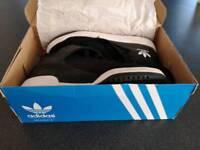 Adidas size 7 UK trainers