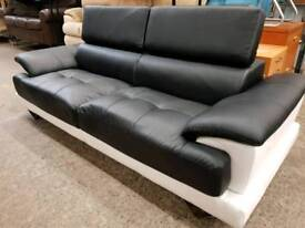 Black and white leather two seater sofa