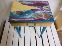 small retro table with acrylic paint detail and palm tree print drawer