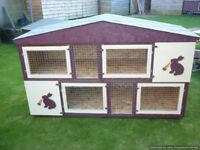 two separate 6 foot rabbit hutches as one hutch