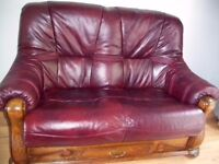 Leather and Oak two seat sofa dark red oxblood decorative ornate frame drawer