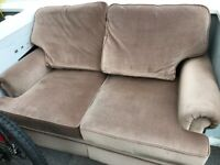 A TWO SEATER SETTEE, LIGHT BROWN FURNITURE BY REID