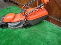 FLYMO EASIMO LAWNMOWER WITH GRASS COLLECTION BOX AND LONG ELECTRIC LEAD ONLY £20 FOR QUICK SALE