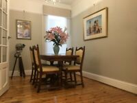 Wooden extendable table and chairs