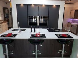 True Handleless Symphony Linear kitchen in Matt Anthracite & Matt Walnut with quartz tops