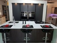 True Handleless Symphony Linear kitchen in Matt Anthracite & Matt Walnut with quartz tops
