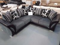Ex Display Black And Grey Corner Sofa. Approx 240cm By 240cm. Ready For Delivery