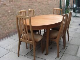 Teak Oval Extendable Dining Table with Six Chairs