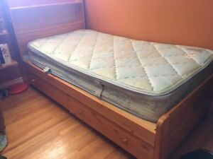 Twin mattress and wood frame