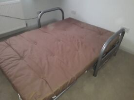 .Futon double, excellent condition, thick mattress unmarked.