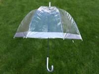 A 60's inspired retro silver/clear umbrella, made by designers Fulton