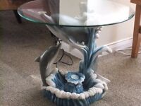 Glass top coffee table on Dolphins with water feature
