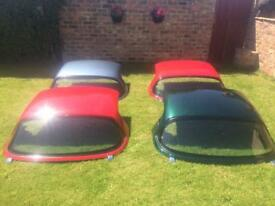 Silver Mazda MX5 hard top roof with heated screen
