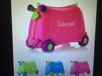 Sit & Ride suitcase, brand new in green and pink