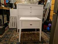White chest of drawers and matching bedside table