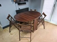 Drop leaf dining table with 4 folding chairs