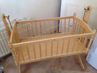 Larger swinging crib with mattress