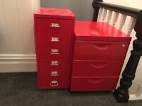 Two bright red small filing cabinets
