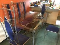 Stunning Glass Dining Table and 8 Matching Chairs