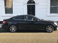 Impeccable Black Mercedes Coupe AMG line