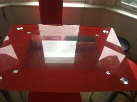 Red glass table and chairs