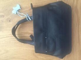 Radley small black leather handbag with dog tab and bag