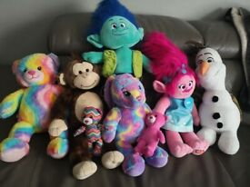 Assorted Build Bears soft toys.