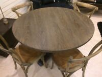 5 FT ROUND OAK TABLE AND 4 CHAIRS