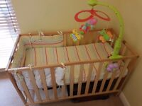 Baby/toddler cot with matress and music carousel
