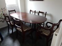 Wooden, extensible, dining table with six matching chairs