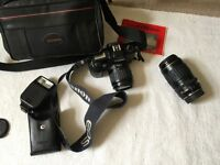 Vintage Canon Camera with two lenses and Canon flash, in case, instruction book and carrying case