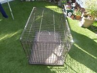 medium size pet/dog cage used but still a lot of life in it