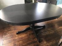 Stunning round/oval extendable dining table
