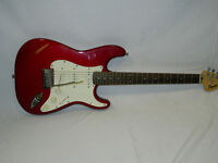 Red 'Squire Stratocaster' electric guitar in case. No S/NIC060605397