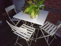 White garden table and 4 chairs
