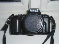 Nikon Camera F-601 with 35-70mm zoom lens, filters etc. and bag