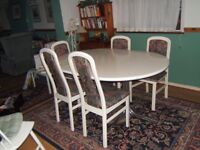 White wooden dining table and 5 chairs
