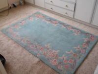Green Rug with Pink Flowered Edging