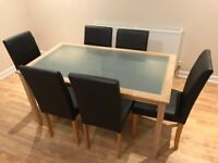 6 Faux Leather Brown Dining Chairs and Wooden and Glass Dining Table